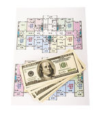 Hundred dollar bills money pile on blueprints with an architecture model in the background — Stock Photo