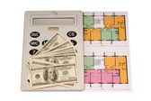 Hundred dollar bills money pile and and calculator on blueprints with an architecture model in the background — Stock Photo