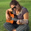 Young Peruvian Woman Playing the Guitar — Stock Photo