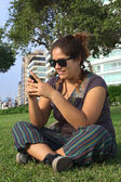 Young Peruvian Woman Typing on Mobile Phone — Stock Photo