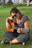 Young Peruvian Woman Playing the Guitar — Stock Photo