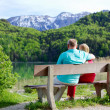 Stock Photo: Elderly couple rests on bench