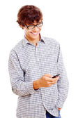 College guy with mobile phone in his hand — Stock Photo
