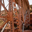 Stock Photo: Metal bridge spans canyon