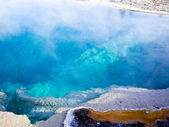 Steaming blue thermal pool Yellowstone — Stock Photo