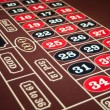 Stock Photo: Roulette felt tabletop with black and red numbers