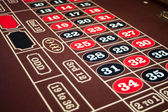 Roulette felt tabletop with black and red numbers — Stock Photo