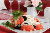 Salad with chicken, grapefruit and prunes — Stock Photo