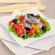 Stock Photo: Appetizer of herring and vegetables with croutons