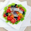 Appetizer of herring and vegetables with croutons — Stock Photo