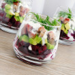 Appetizer in a glass of beet and herring with avocado — Stock Photo