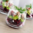 Stock Photo: Appetizer in a glass of beet and herring with avocado