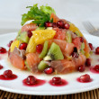 Fruit salad with salmon and pomegranate — Stock Photo