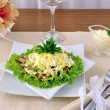 Salad with ham, cucumber, egg under the chips - Stock Photo