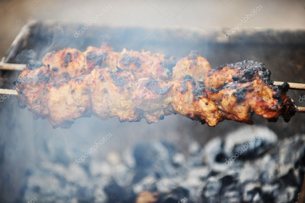 Preparation of meat slices in sauce on fire — Stock Photo #11219306