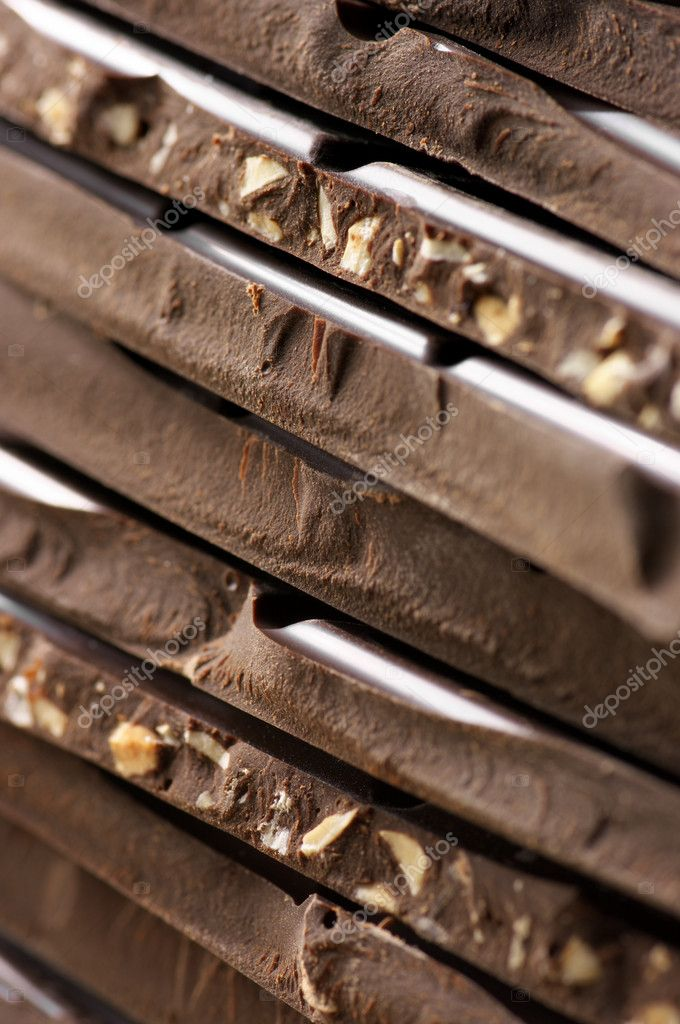 Close-up of stacked assorted dark chocolate. Shallow DOF. — Stock Photo #11101917