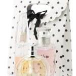 Female perfumes and bag — Stock Photo #11332340