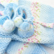 Baby&amp;#039;s knitted clothes - Stock Photo