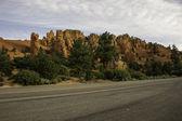 Hills at roadside — Stock Photo