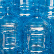 Big empty water bottles at warehouse — Stock Photo