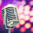 Retro microphone on purple disco background — ストック写真