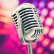 Retro microphone on purple disco background — Foto Stock