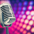 Retro microphone on purple disco background — Stock Photo #12044772