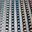 Studio mixer knobs and faders — Stock Photo