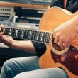 Left-handed man playing guitar, close-up — Stock Photo