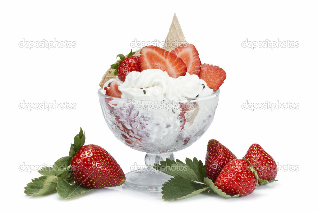 Strawberries and whipped cream cup isolated over a white background.  Stock Photo #11092683