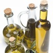 Set of olive oil bottles and black olives. — Stock Photo