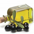 Black olives and a bottle of olive oil. — Stock Photo
