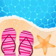 Flip-flops and starfish by the seaside — Stockvectorbeeld