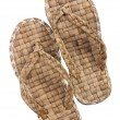 Stock Photo: Summer footwear is weaved from straw