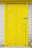 Yellow old wooden door — Stock Photo