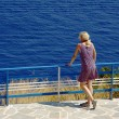 Girl on seashore at Zakynthos island -  
