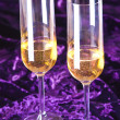 Two wineglasses with champagne on velvet — Stock Photo