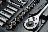Close up shot of kit of metallic tools — Stock Photo