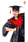 Happy graduating woman holding a display for text — Stock Photo