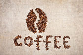 Coffee bean on old burlap canvas — Stock Photo