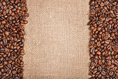 Coffee beans and sackcloth — Stock Photo