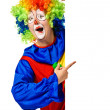Happy clown holding the blank board — Stock Photo #12055205