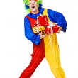 Birthday clown holding gift boxes — Stock Photo #12144919