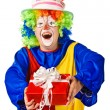 Happy birthday clown with gift box. — Stock Photo