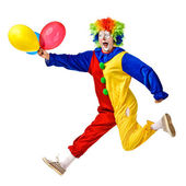 Portrait of a happy clown jumping with balloons — Stock Photo