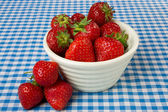 Bowl of Strawberries on a Blue Gingham Tablecloth — Stock Photo