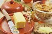 Butter on ceramic plate — Stockfoto