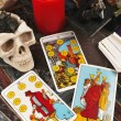 Tarot cards with burning candle — Stockfoto