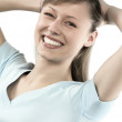 Closeup portrait of a happy young woman - Stock Photo