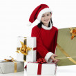 Royalty-Free Stock Photo: Happy girl with christmas hat and big present